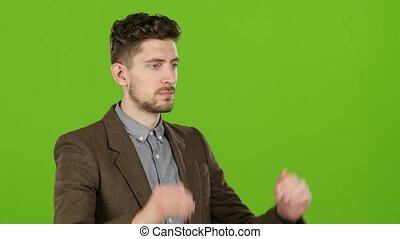 Businessman types the text on the virtual keyboard. Green Screen