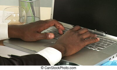 Businessman typing a laptop