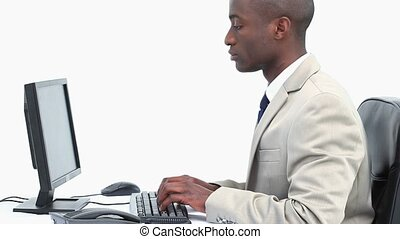 Businessman typing on a keyboard and doing a mistake against...