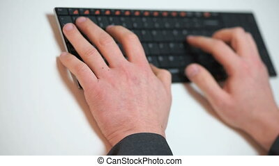 businessman typing on a keyboard