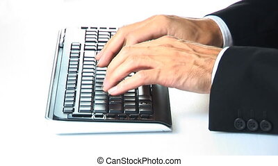 businessman typing on keyboard closeup
