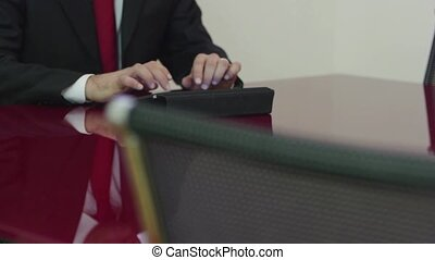 Businessman typing on touch pad pc