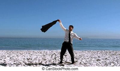 Businessman undressing then throwin