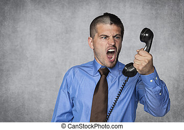 businessman unloads anger on the employee by phone