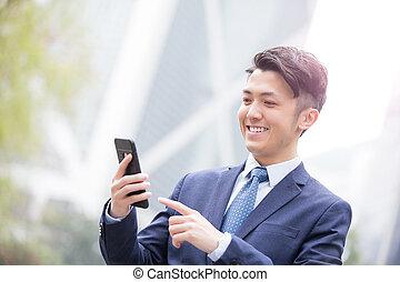 Businessman use smart phone
