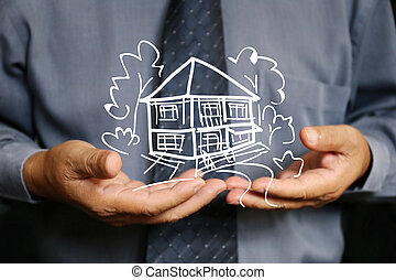 businessman use two hand hold house