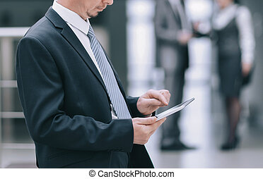businessman uses a digital tablet in the office
