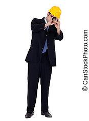 businessman using a blueprint as a binoculars