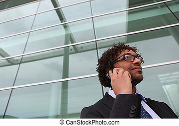 Businessman using a cellphone in the city