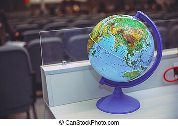 Businessman using a laptop with close up on world globe. Global concept. Blue Globe Against Blurred World Map. Globe sphere orb model effigy. vintage style .