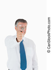 Businessman using a magnifying glass
