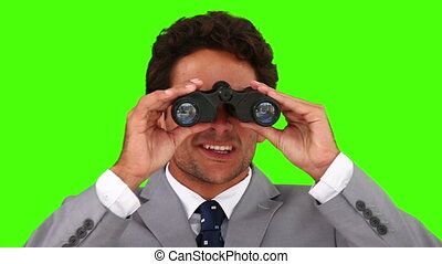 Businessman using a pair of binoculars - Chromakey footage...