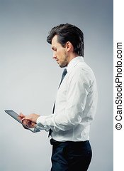 Businessman using a touchpad