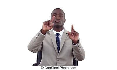 Businessman using a virtual touchscreen