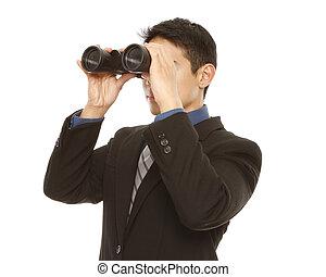 Businessman Using Binoculars - A man in business attire ...