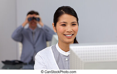 Businessman using binoculars in the background