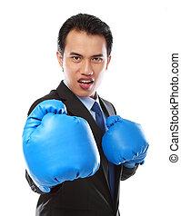businessman using boxing glove