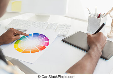 Businessman using colour sample and digitizer