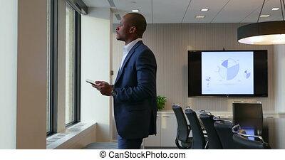 Businessman using digital tablet in office 4k