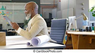 Businessman using digital tablet in the office 4k