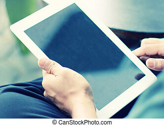 Businessman using digital tablet.