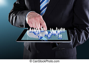 Businessman Using Digital Tablet With World Map