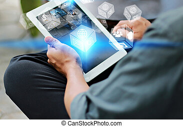 Businessman using digital tablet,hand touching screen on digital tablet with social icons.