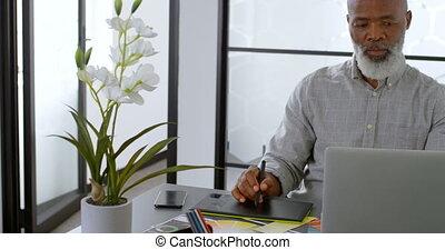 Businessman using graphic tablet on desk 4k - Businessman...