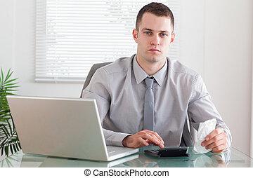 Businessman using his calculator