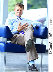 Businessman using his tablet in the office