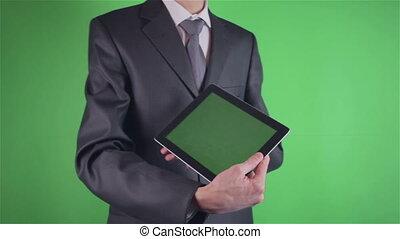 Businessman using his tablet on chroma key