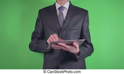 Businessman using his tablet on chroma key or Green screen