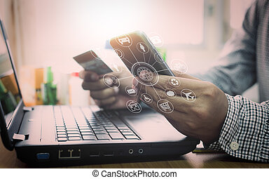 Businessman using laptop and mobile phone to online shopping.