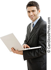 Businessman using laptop computer, standing and holding the...
