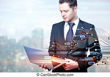 Businessman using laptop with circuit