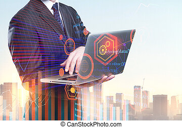 Businessman using laptop with HTML code