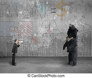 Businessman using megaphone yelling at black bear with doodles w
