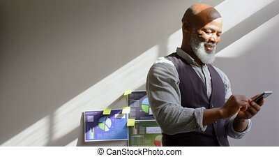 Businessman using mobile phone in office 4k