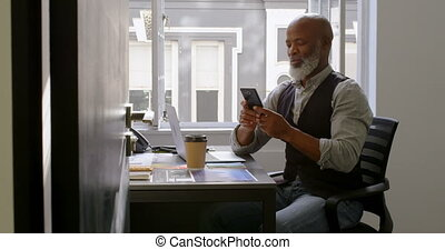 Businessman using mobile phone on desk 4k - Businessman...