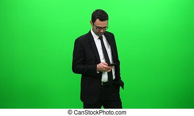 Businessman Using Mobile Phone on Green Screen