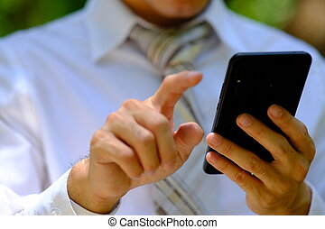 Businessman using smart phone and business people use technology concept