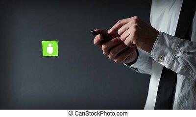Businessman using smartphone.