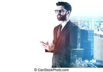 Happy young european businessman using smartphone on white city background with copy space. Technology and communication concept. Double exposure
