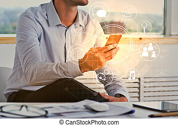 Businessman using smartphone with business diagram