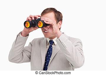Businessman using spy glasses