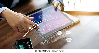 Businessman using tablet analyzing sales data and economic growth graph. Business planning and strategy. Digital marketing.