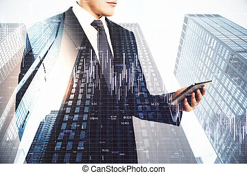 Businessman using tablet and digital falling chart