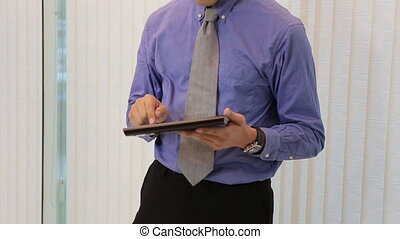 businessman using tablet computer online shopping from...