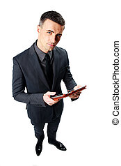 Businessman using tablet computer isolated on a white background
