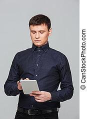Businessman using tablet computer